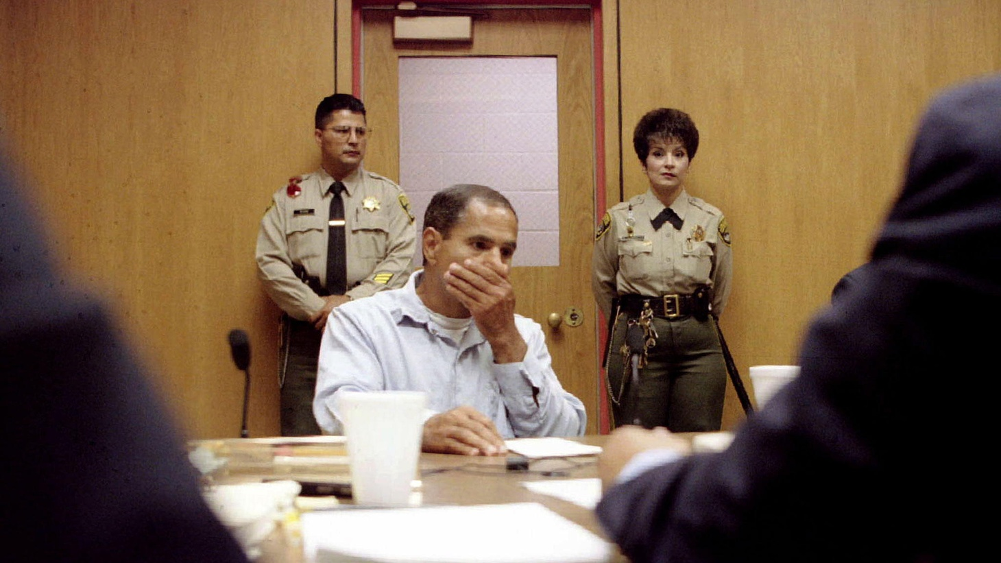 Sirhan Sirhan listens as the parole board (foreground) gives him the reasons it is denying him parole at his tenth parole hearing at the Corcoran State Prison in Corcoran, California, June 18, 1997. Sirhan was convicted of slaying Sen. Robert Kennedy.