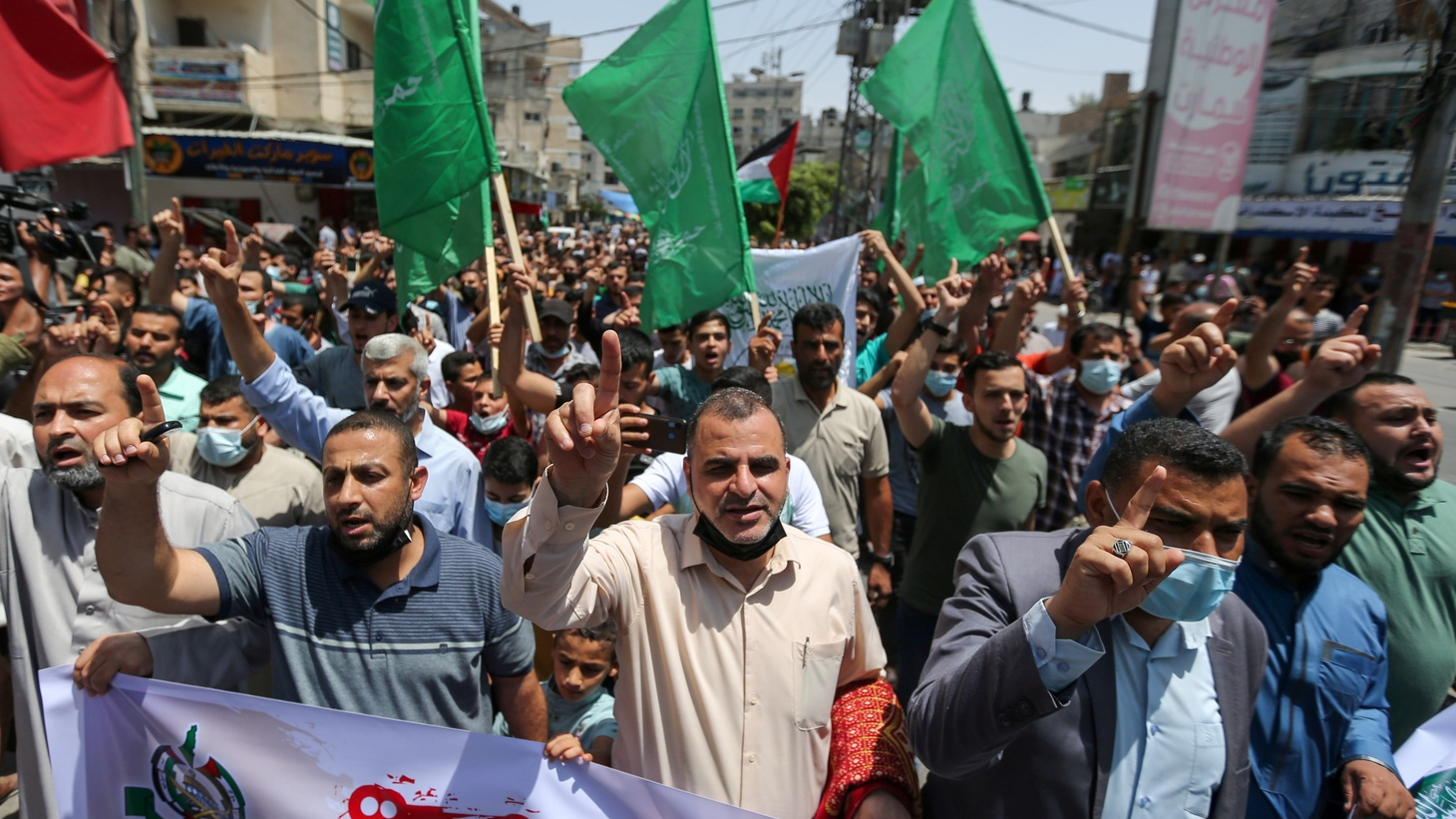 Palestinian Hamas supporters take part in a rally to celebrate following Israel-Hamas truce in the southern Gaza Strip, May 21, 2021.