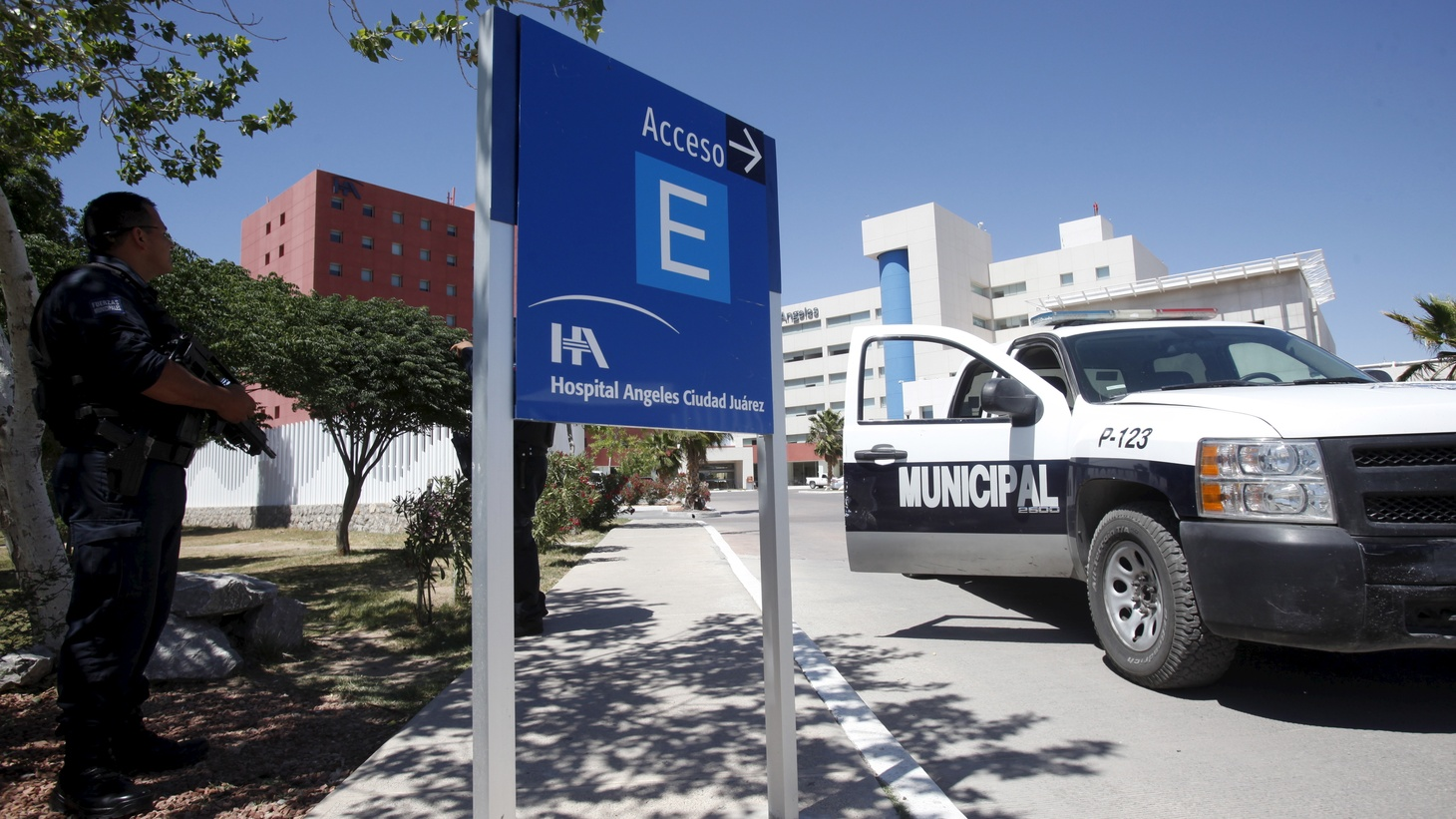 Police guard a local hospital where Julian Leyzaola Perez receives treatment after being attacked in Ciudad Juarez, May 9, 2015.