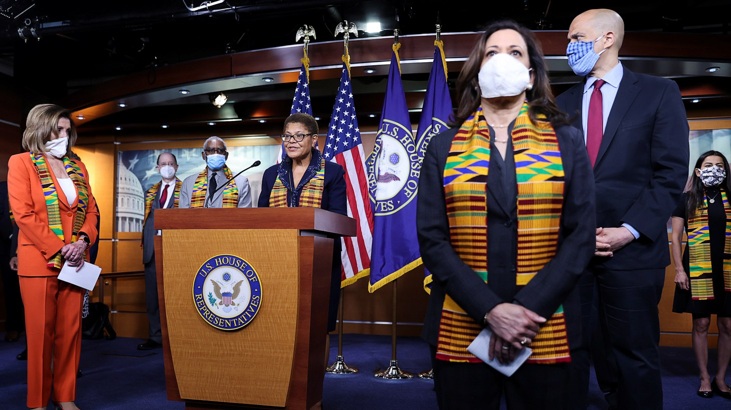 Congressional Black Caucus Chairwoman Representative Karen Bass (D-CA) addresses reporters during a news conference to unveil police reform and racial injustice legislation at the U.S. Capitol in Washington, U.S. House Speaker Nancy Pelosi (D-CA) listens with Senators Kamala Harris (D-CA) and Cory Booker (D-NJ). June 8, 2020.