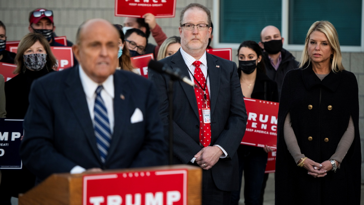 Former New York City Mayor Rudy Giuliani, personal attorney to U.S. President Donald Trump, speaks next to Trump campaign ballot counting observer Jeremy Mercer and former Florida Attorney General Pam Bondi during a news conference to discuss filing election-related lawsuits at Atlantic Aviation PHL private air terminal in Philadelphia, Pennsylvania, U.S. November 4, 2020.