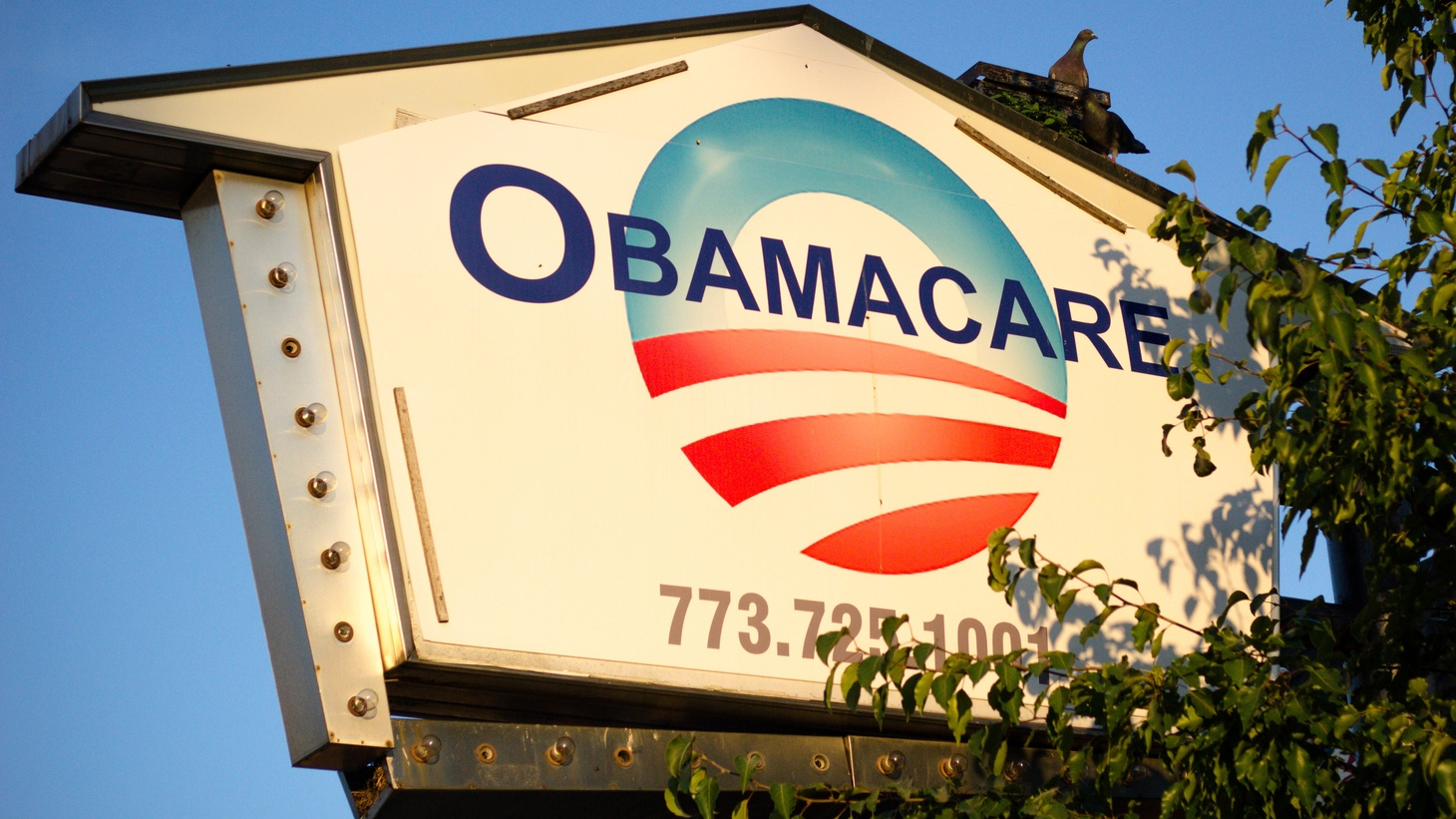 A sign for Obamacare is seen in Chicago, Illinois. Today the Supreme Court justices upheld the health care law.