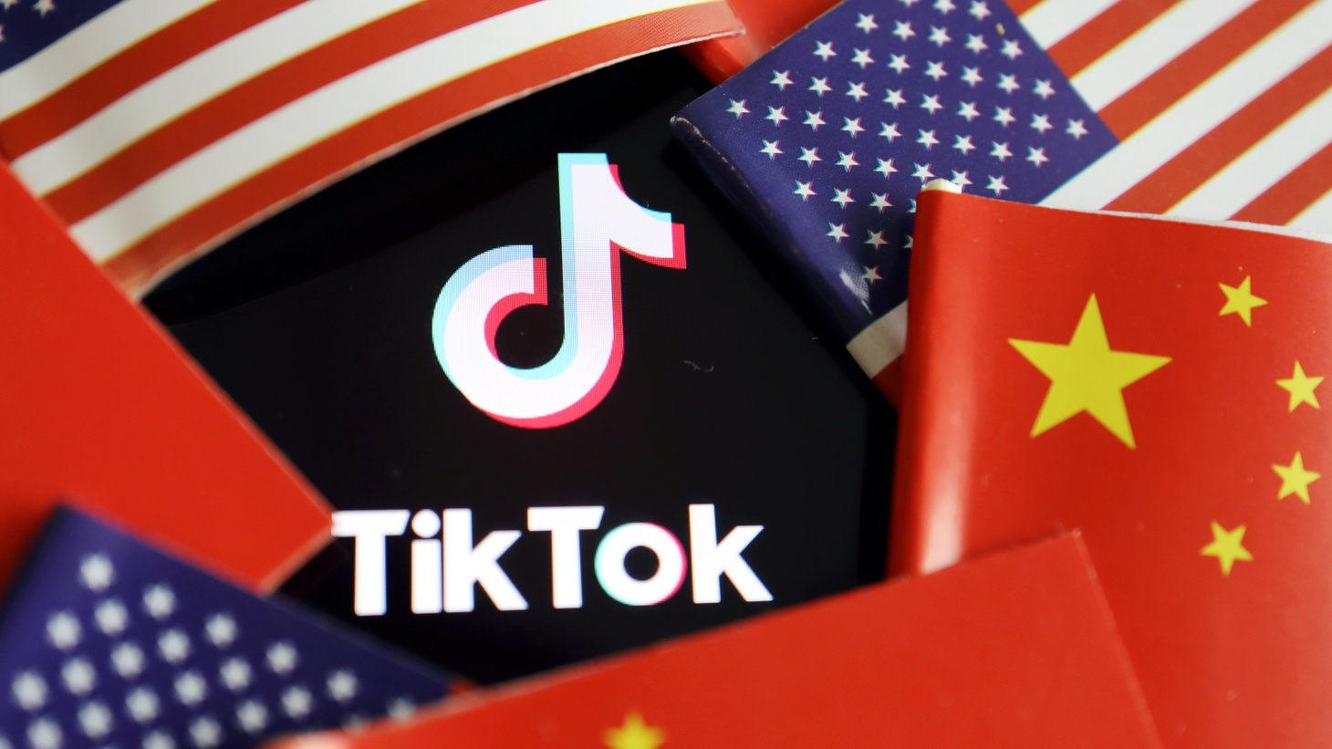 Chinese and U.S. flags are seen near a TikTok logo in this illustration picture taken July 16, 2020.