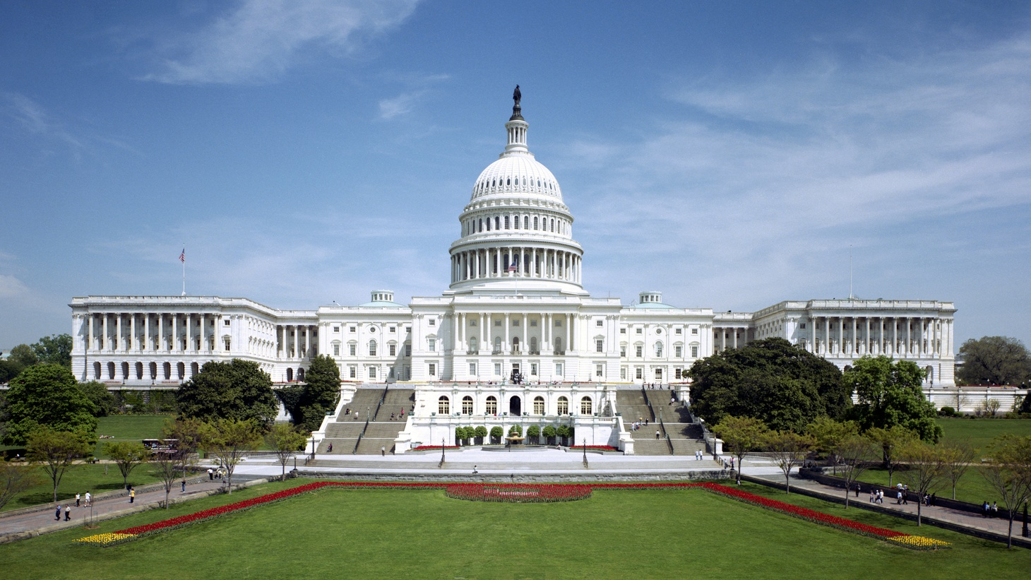 The western front of the United States Capitol. The Neoclassical style building is in Washington, D.C., on Capitol Hill, at the east end of the National Mall. The Capitol was designated a National Historic Landmark in 1960.