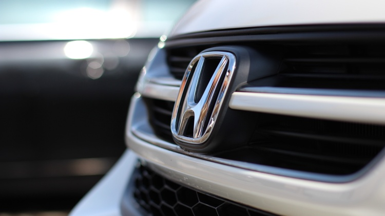 The Justice Department has begun an investigation into whether four automakers colluded with California to make cars with stricter fuel efficiency standards.