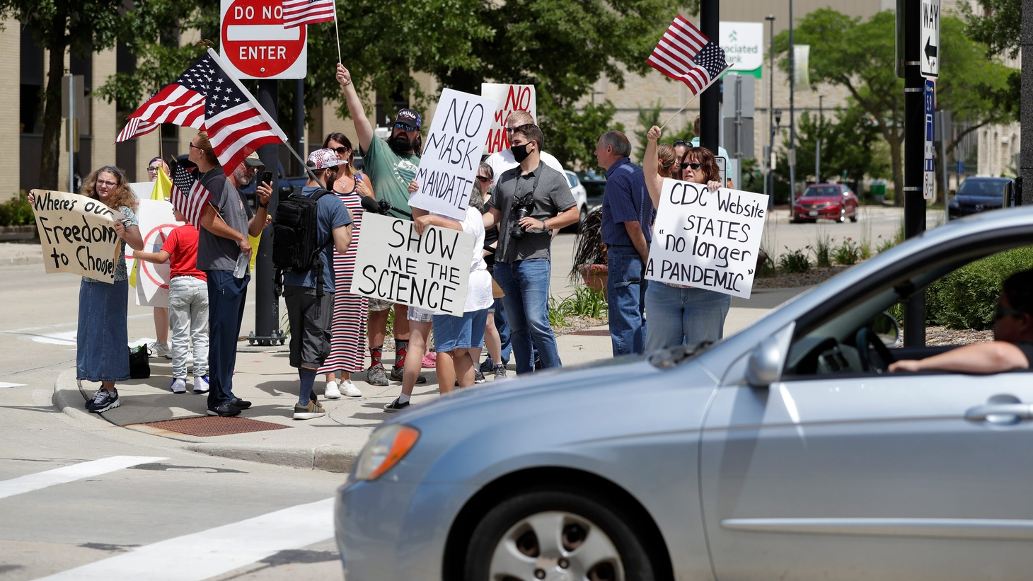 Anti-mask protesters stand outside City Hall while Mayor Eric Genrich announced his plan to implement an indoor face mask requirement throughout Green Bay during a press conference on July 20, 2020, in Green Bay, Wis.