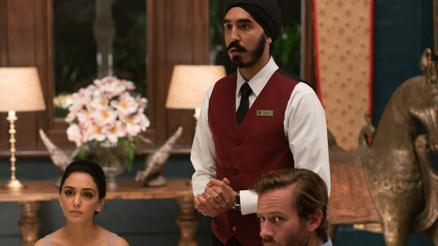 "Nazanin Boniadi as ""Zahra,"" Dev Patel as ""Arjun,"" and Armie Hammer as ""David"" in director Anthony Maras' ""Hotel Mumbai."""