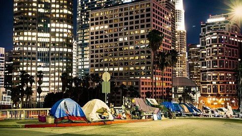 Homeless encampments line a street by the freeway in downtown Los Angeles. Mayor Eric Garcetti's spending plan for the next fiscal year includes nearly $1 billion to fight homelessness.