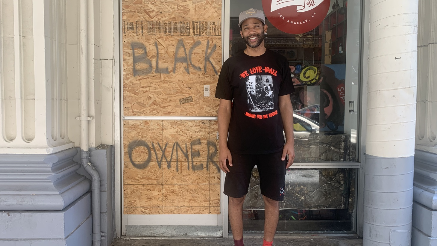 Someone put up a sign stating that Joel Stallworth was a black owner after his shop, The Small Shop LA, was looted.