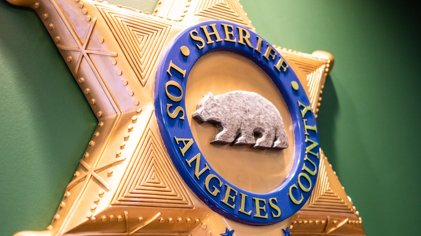 A large plaque hangs on the wall of LA County Sheriff Alex Villanueva's office in downtown LA. On September 12 in Compton, two sheriff's deputies were shot at point-blank range while sitting in their car.