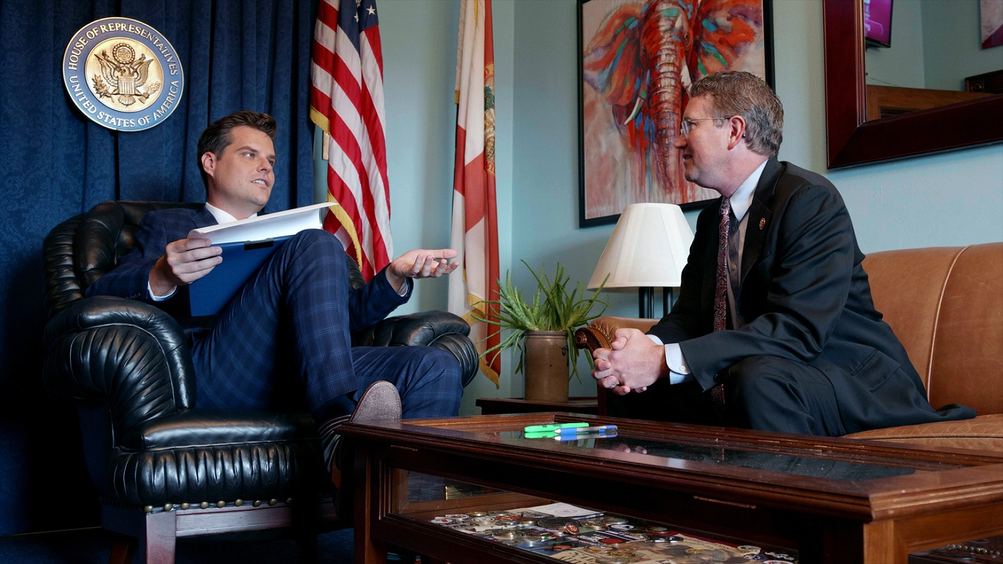 Rep. Matt Gaetz (R-FL), left, and Rep Thomas Massie (R-KY), right, talking about fundraising in Gaetz's office.