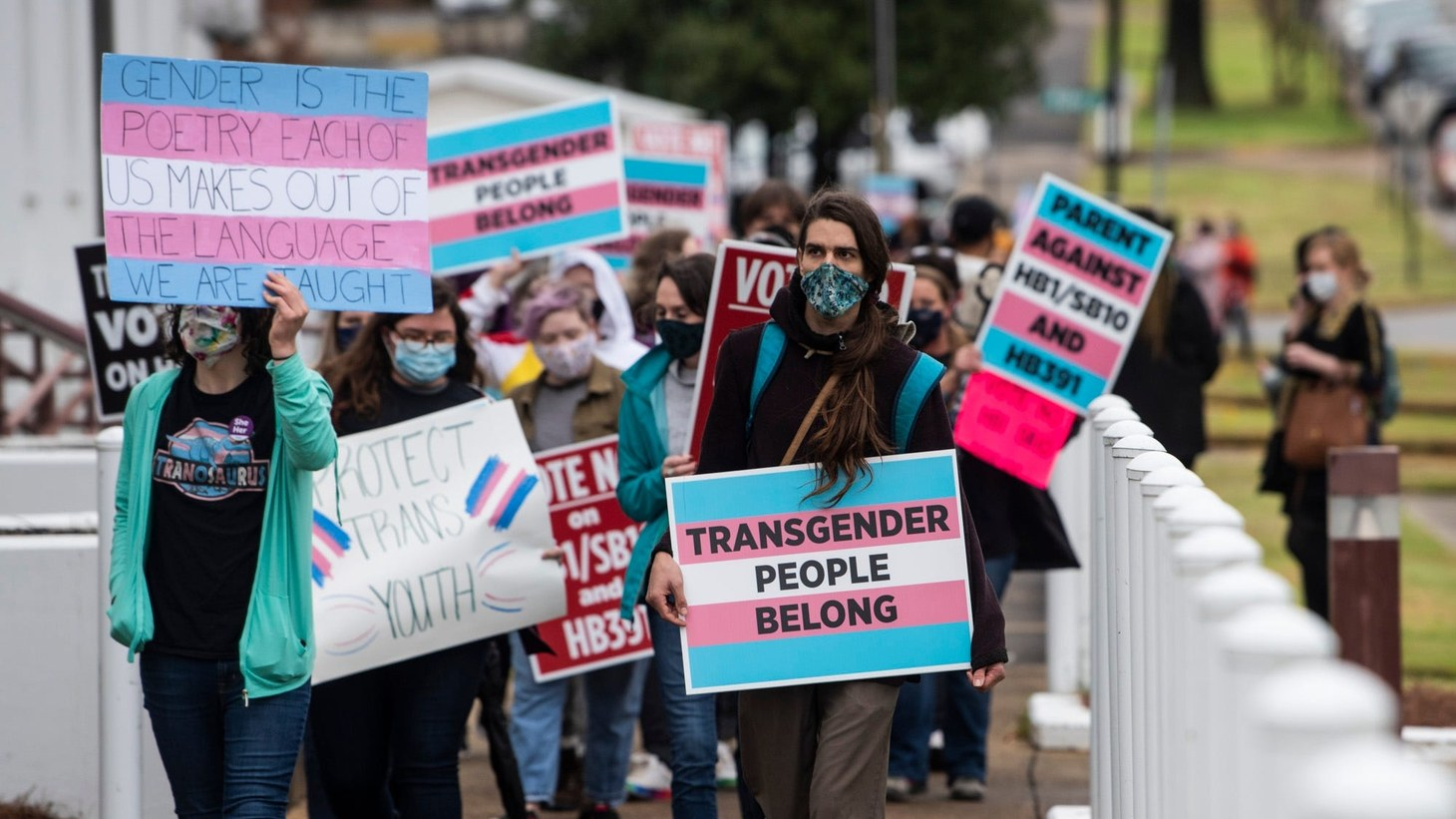 Protestors in support of transgender rights march around the Alabama State House in Montgomery, Ala., on Tuesday, March 2, 2021.