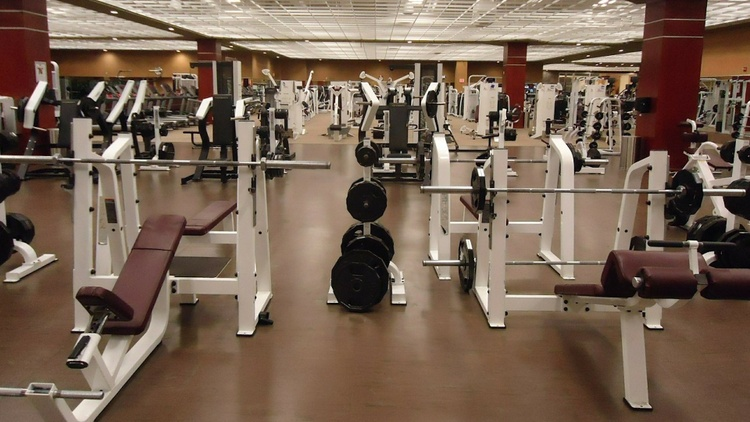 Gyms are reopening now and must adhere to certain guidelines, like screening for fevers and coughs, requiring social distancing and masks.