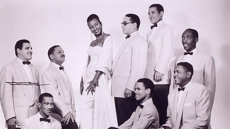 """Celia Cruz in the 1950s with the members of the Sonora Matancera in Havana. Her song """"I Will Survive"""" is part of KCRW DJ Novena Carmel's recommendations for the summer."""