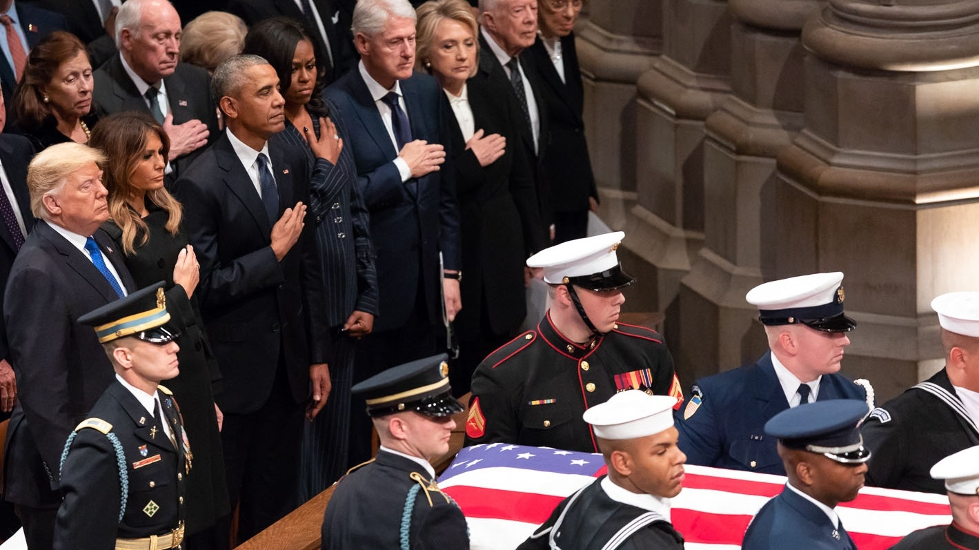 President Donald J. Trump and First Lady Melania Trump, joined by former President Barack Obama and First Lady Michelle Obama, former President Bill Clinton and First Lady Hillary Clinton and former President Jimmy Carter and First Lady Rosalynn Carter, watch as the casket of former President George H. W. Bush arrives to the funeral service Wednesday, Dec. 5, 2018, at the Washington National Cathedral in Washington, D.C.