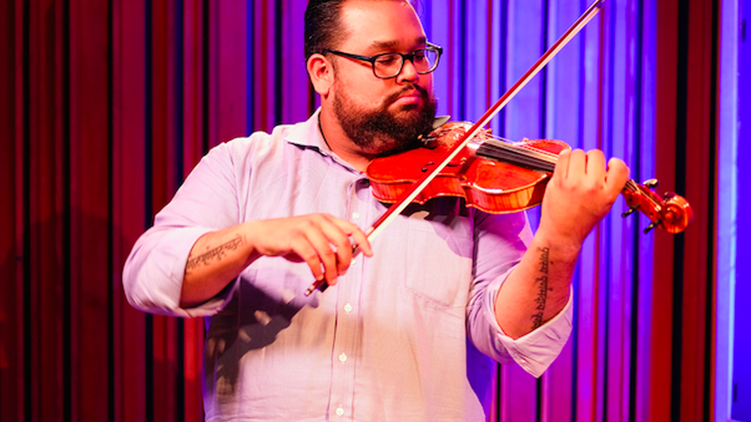 """LA Phil violinist Vijay Gupta recently won a MacArthur """"genius"""" grant. He's known for launching Street Symphony, a nonprofit that brings classical music to Skid Row, homeless shelters, and the LA County jail."""