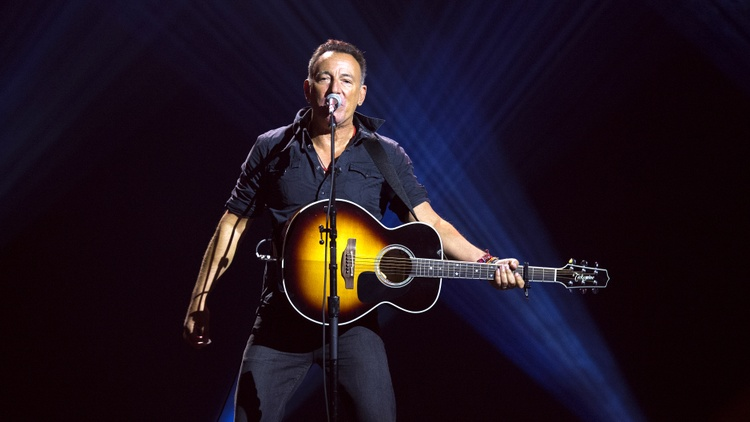 Bruce Springsteen is often seen as the the All-American man, especially with his blue jeans and Super Bowl halftime performances with the huge firework displays.   