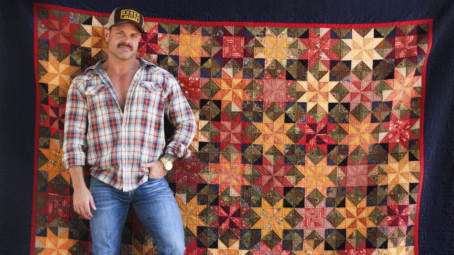 Dale Allen-Rowse with one of his quilts.