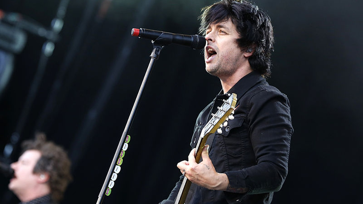Billie Joe Armstrong, singer and guitarist of Green Day, stands on the Center Stage of Rock im Park-Festival 2013.