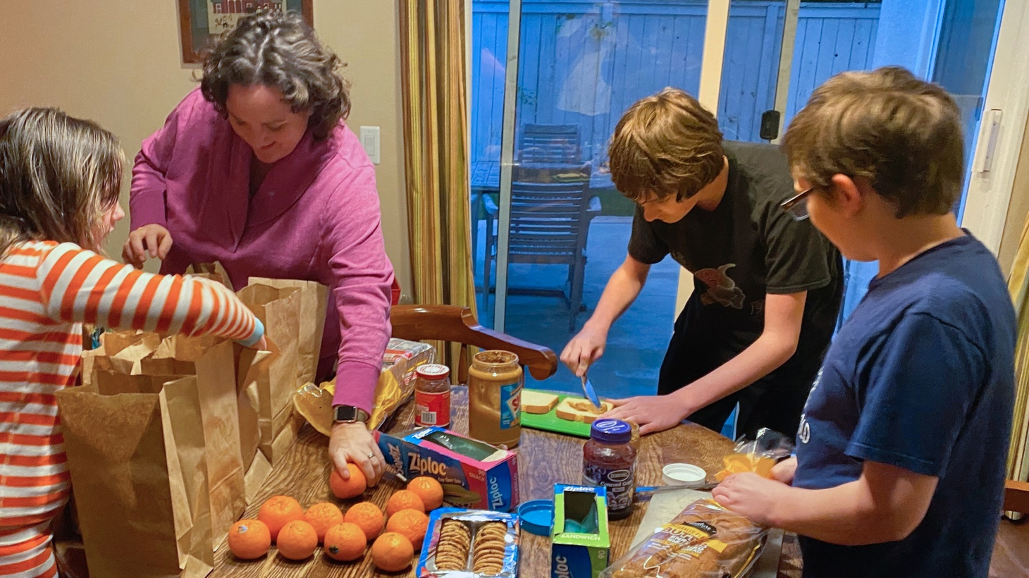 Rep. Katie Porter left Washington D.C. and returned to her Orange County home in mid-March when social distancing became necessary and schools shifted to online classes. In this photo, she and her kids are making sack lunches for people experiencing homelessness.