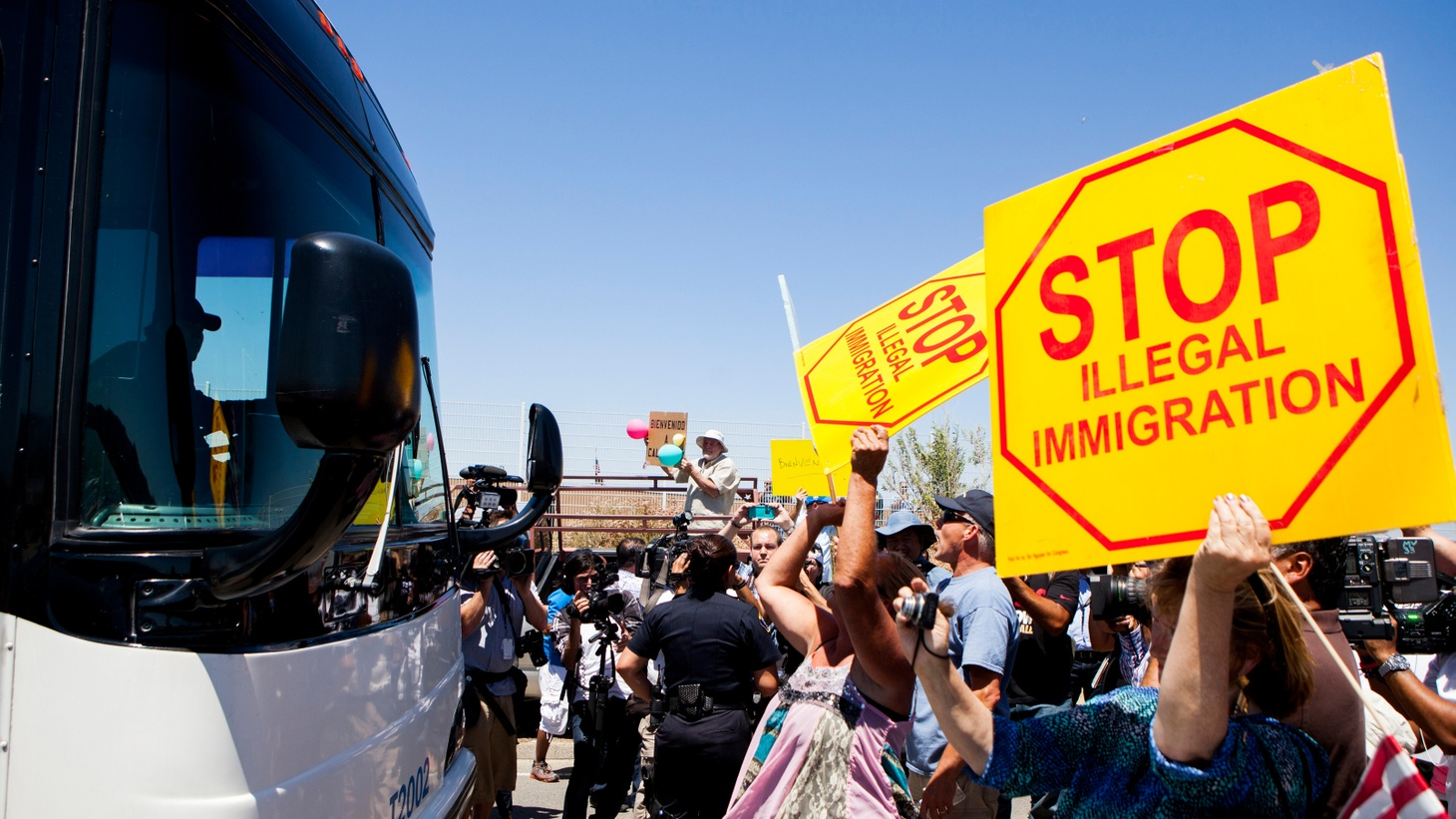 "Buses with 140 undocumented migrants blocked by protesters on their way to Murrieta. Extreme violence in Central America is pushing many people north. We also meet the men behind ""Future Folk"", a sci-fi bluegrass band. And our tech expert introduces us to ""black phones"", robot legs, and a computer chef."