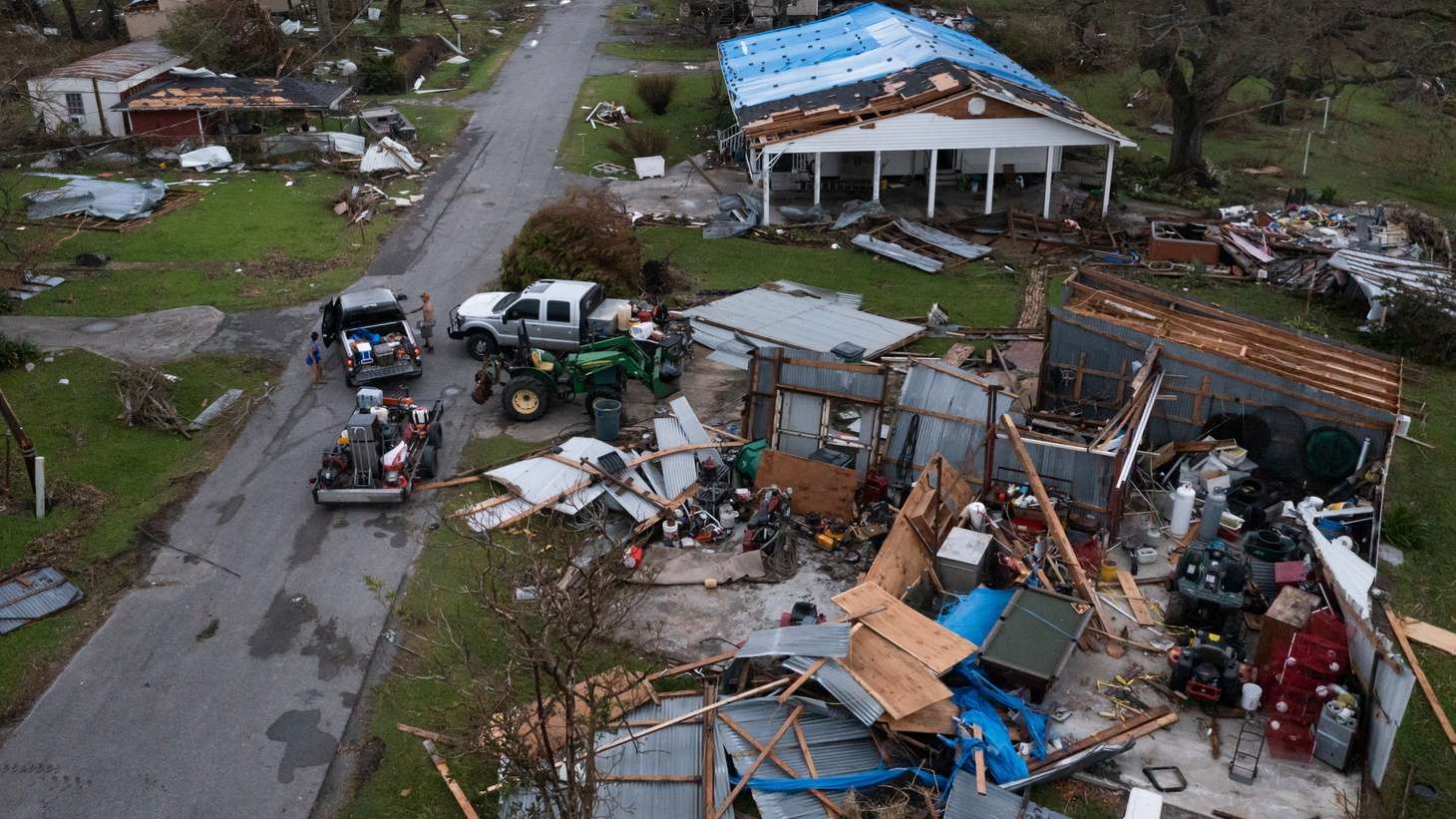 People collect belongings from their damaged property in the aftermath of Hurricane Ida in Golden Meadow, Louisiana, U.S., September 1, 2021.