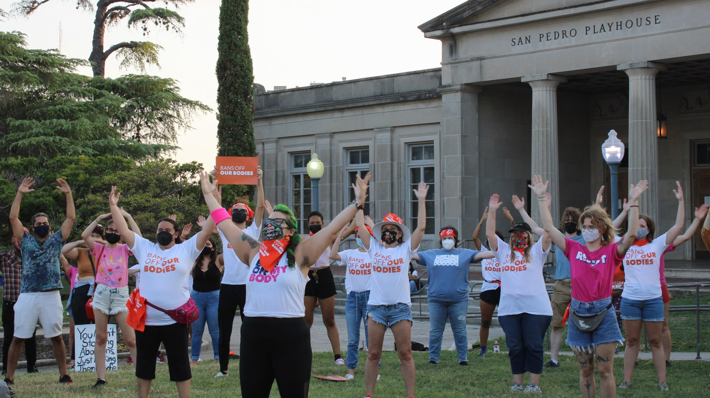 """People participate in """"Bans Off Our Bodies!"""", a performance protest in front of the San Pedro Playhouse in San Antonio, Texas, on September 1, 2021. The demonstration is in response to SB8, a new Texas state law that bans abortion after as six weeks into pregnancy."""