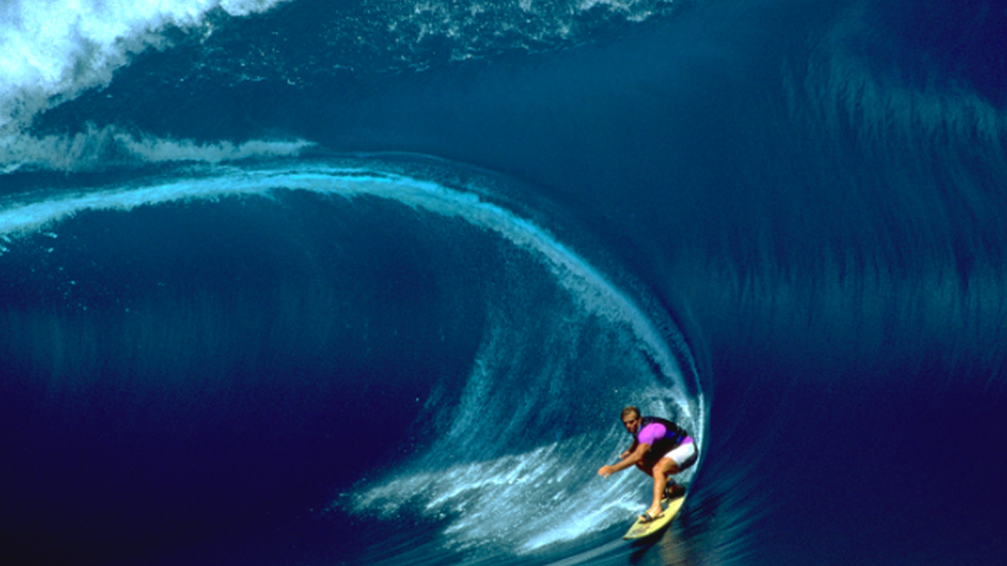 """A new film film spotlights big wave surfer Laird Hamilton's tumultuous upbringing in Hawaii, his love of the ocean, and his """"fear defect."""" What drives him to chase monster waves all over the world?"""