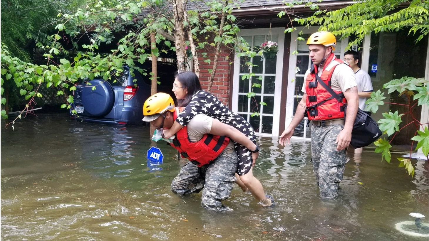 Tropical Storm Harvey is on par with Hurricane Katrina in terms of devastation. How has the official response been? We talk with a woman who was rescued, and a man who traveled from Louisiana to help people stranded on rooftops.