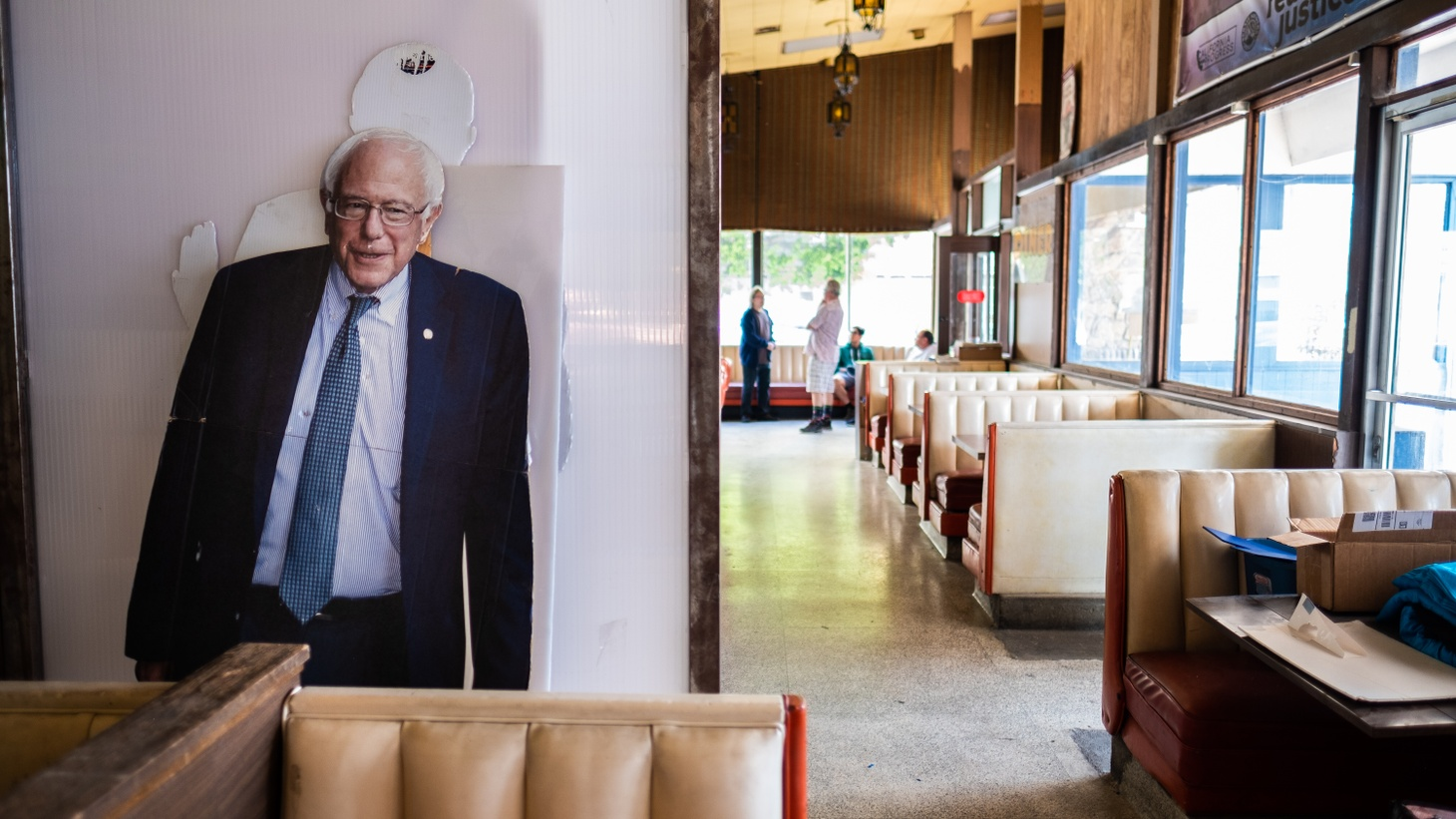 A cardboard candidate Bernie Sanders stands at the back of Bernie's Coffee Shop in Mid City, Los Angeles.