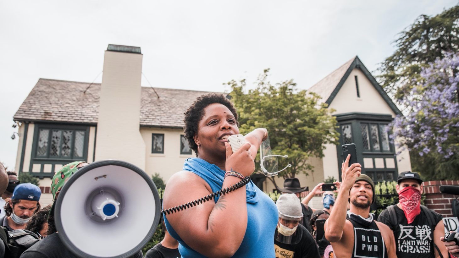 Patrisse Cullors participates in a protest in front of LA Mayor Garcetti's home. June 2, 2020.