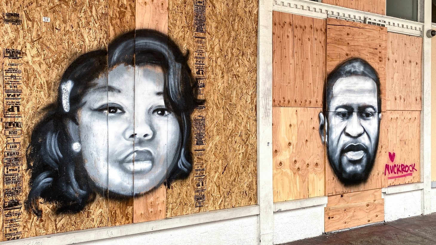 An artist has painted the faces of Breonna Taylor and George Floyd on a boarded-up business in Venice, California. June 5, 2020.