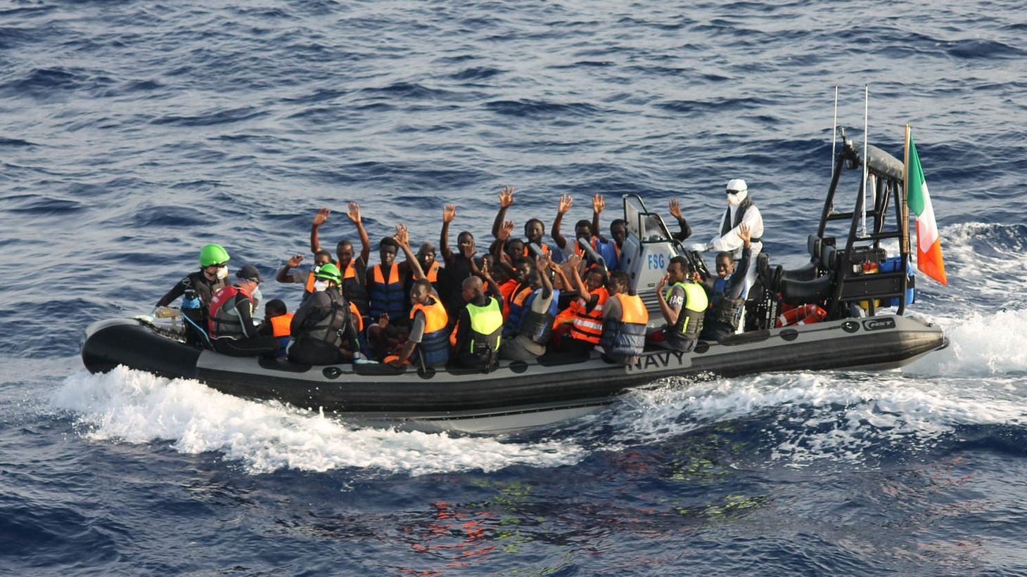 More than 11,000 African migrants were rescued trying to cross the Mediterranean this week. A photographer on one of the boats off Libya's coast captured a dramatic rescue.