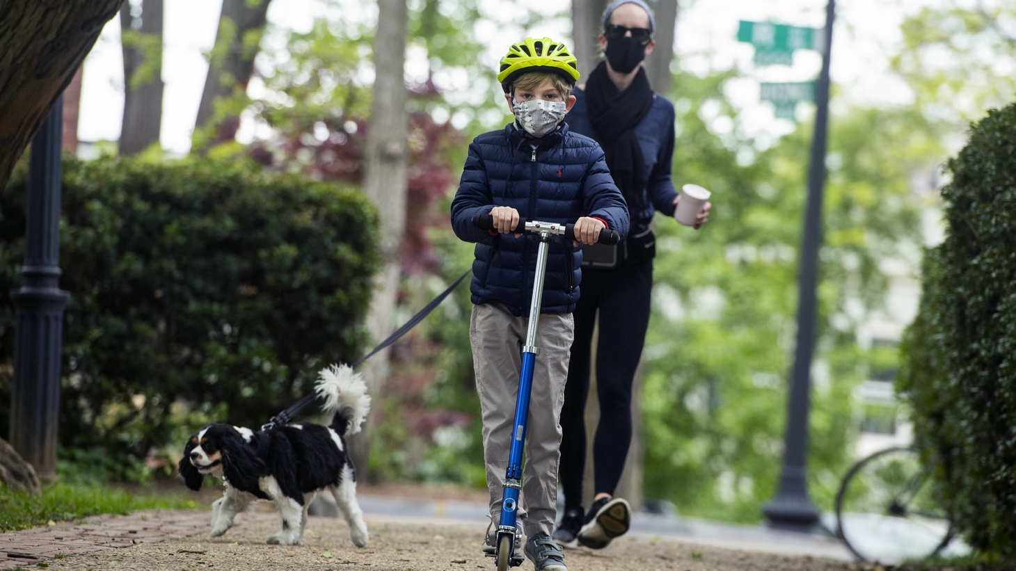 Whitney Rosenthal and her son Parker stroll through Georgetown's Montrose Park on May 11.