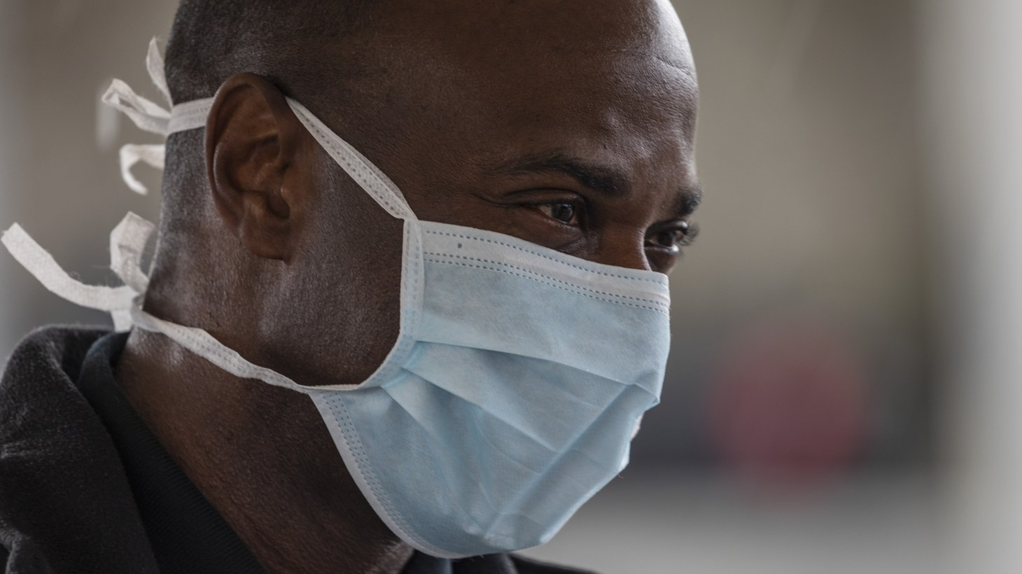 A man wearing a medical mask at a South LA COVID-19 testing site. April 8, 2020.
