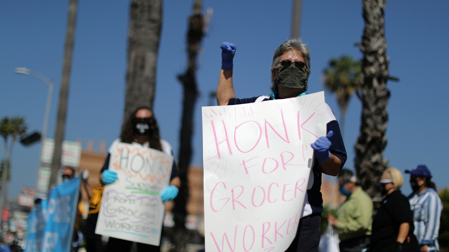 People protest outside Ralph's grocery store, where they say 19 workers have been infected, as the global outbreak of the coronavirus disease (COVID-19) continues, in Hollywood, Los Angeles, California, U.S., May 1, 2020.