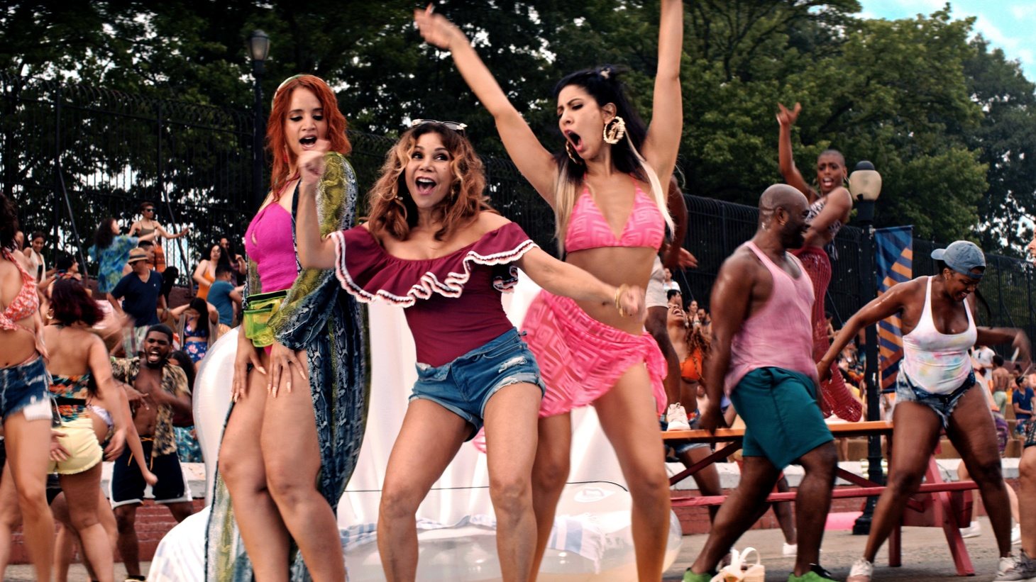 """(Center L to R) Dascha Polanco as Cuca, Daphne Rubin-Vega as Daniela, and Stephanie Beatriz as Carla in """"In the Heights,"""" a Warner Bros. Pictures release."""
