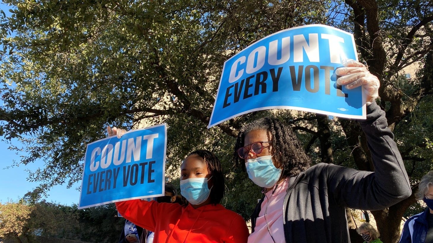 """Pearl Wright and her granddaughter, Kayin Coward, 11, chant """"count every vote"""" outside the federal courthouse in Houston, Texas, U.S., November 2, 2020, where a judge is deciding whether or not to throw out votes for the upcoming presidential election cast with drive-thru voting."""