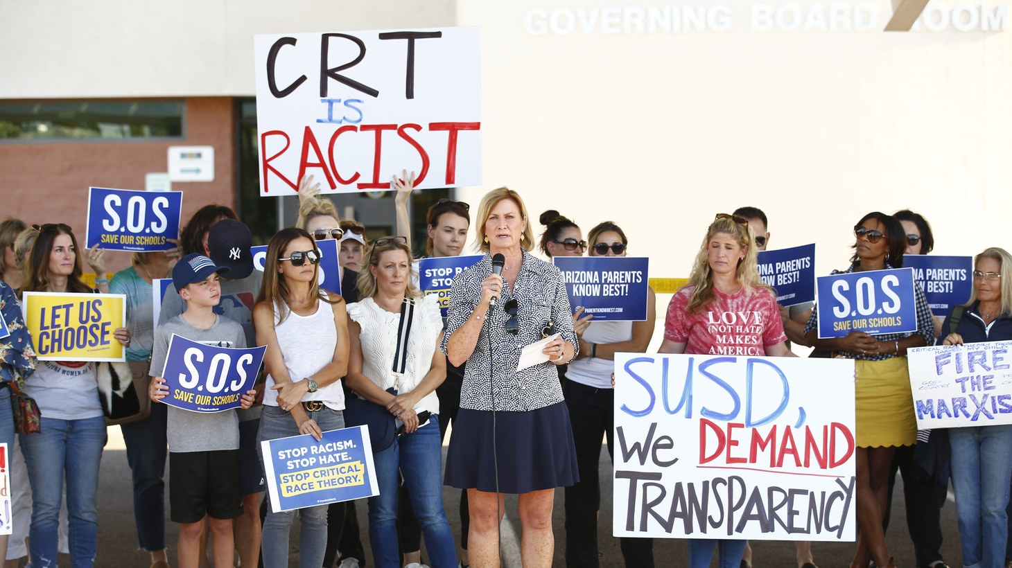 Amy Carney speaks on behalf of parents during a protest against critical race theory being taught at Scottsdale Unified School District, May 24, 2021.