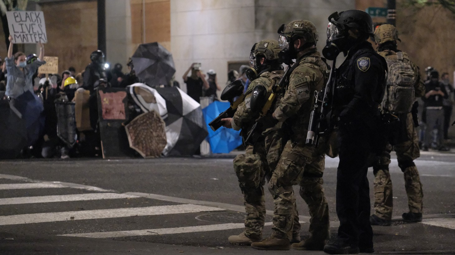 Protesters removed fencing around the front entrance of the federal courthouse in Portland, Ore., and faced off with officers who launched tear gas and other crowd control weapons. July 20, 2020.