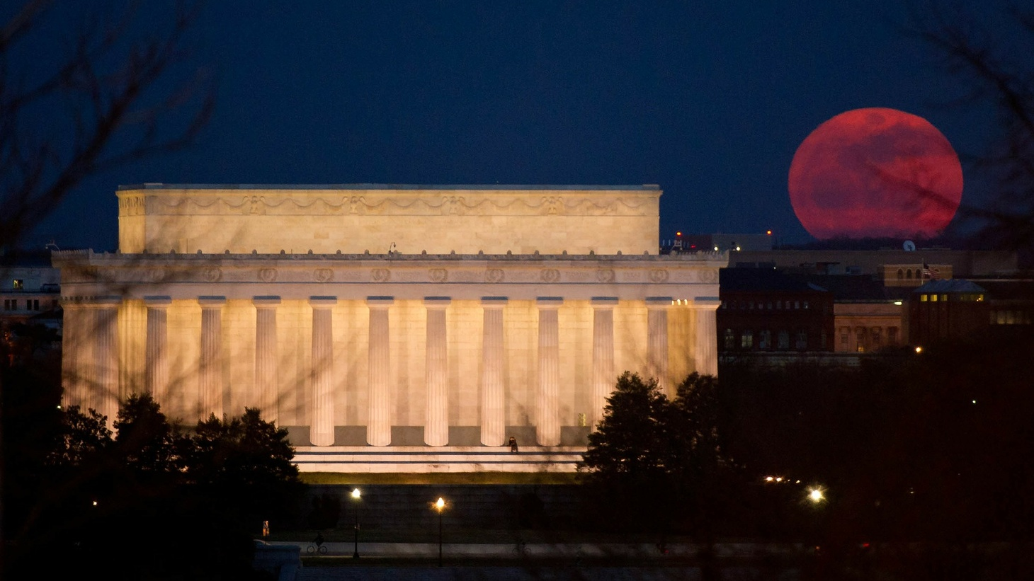 Washington DC at night with a red moon.