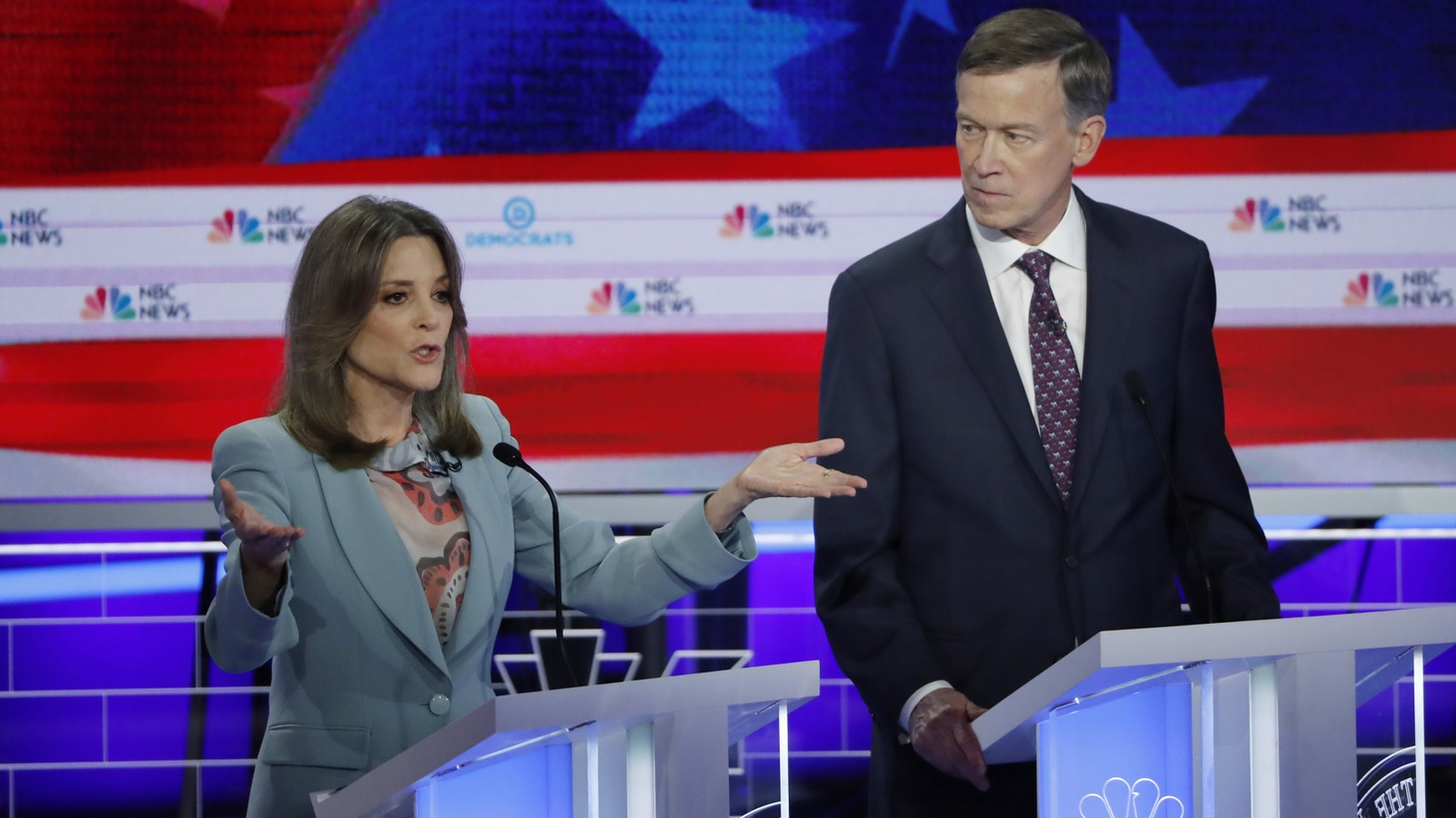 Author Marianne Williamson and former Colorado Governor John Hickenlooper debate during the second night of the first U.S. Democratic presidential candidates 2020 election debate in Miami, Florida, U.S., June 27, 2019.