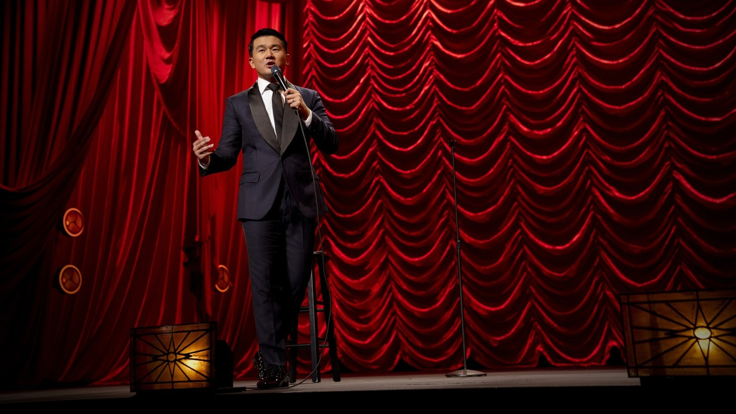 Ronny Chieng performing in his Netflix special.