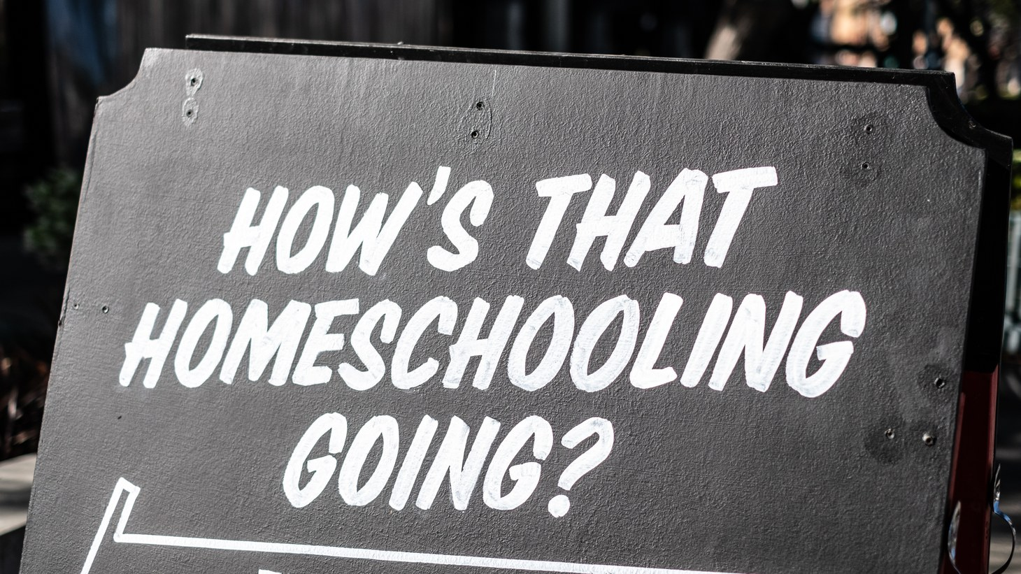 "A sign in Culver City says, ""How's that homeschooling going?"" For some LAUSD students, they don't have laptops, fast internet, a work station, or enough quiet space at home for learning."