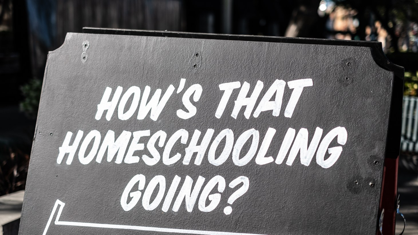 """A sign in Culver City says, """"How's that homeschooling going?"""" For some LAUSD students, they don't have laptops, fast internet, a work station, or enough quiet space at home for learning."""