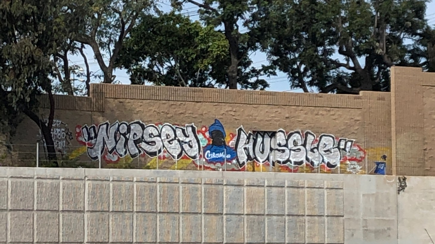 Nipsey Hussle graffiti as seen off the 405 freeway.