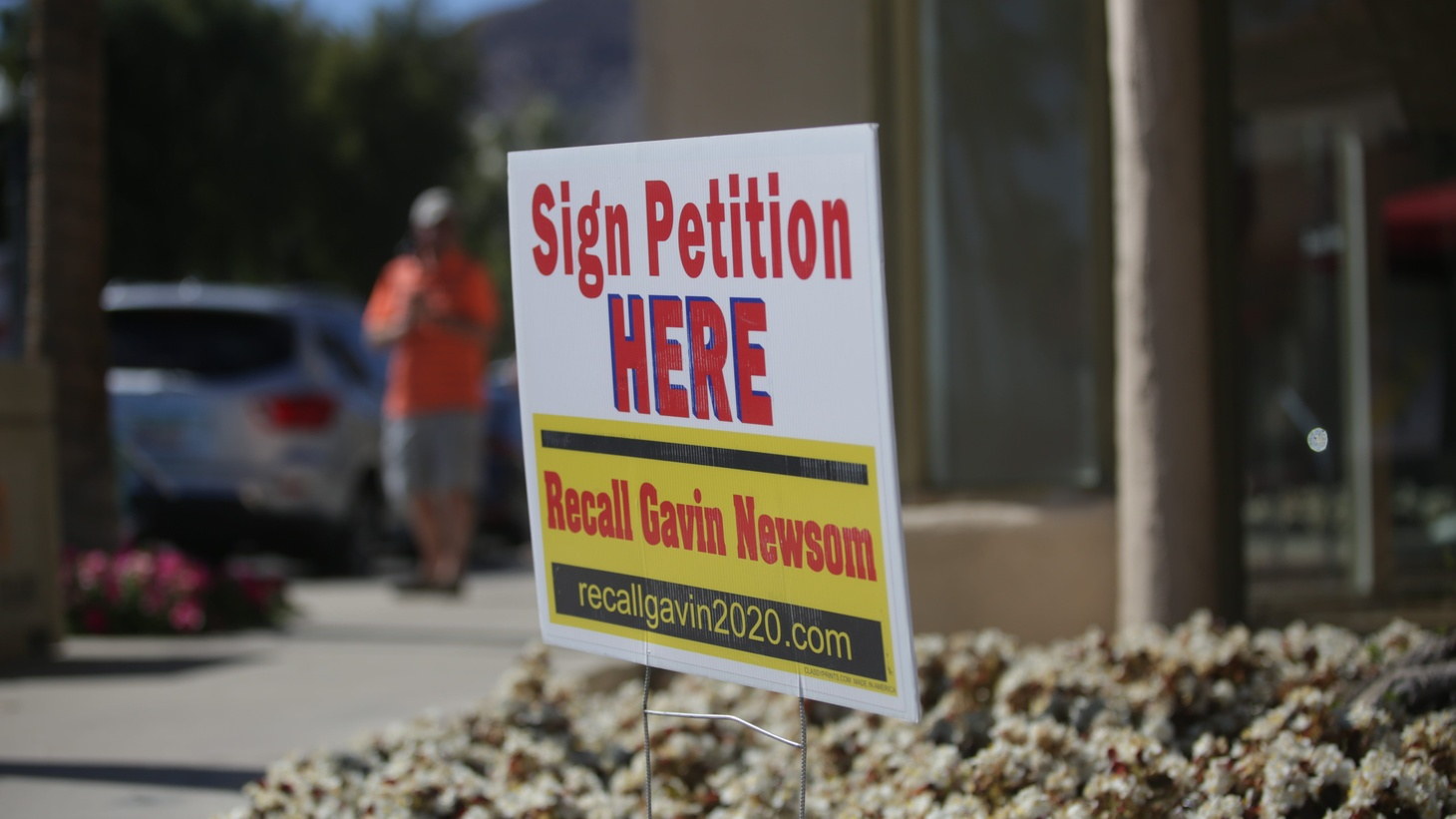 A sign appeals to passersby to recall Gov. Gavin Newsom, February 21, 2021, in Palm Desert, California.