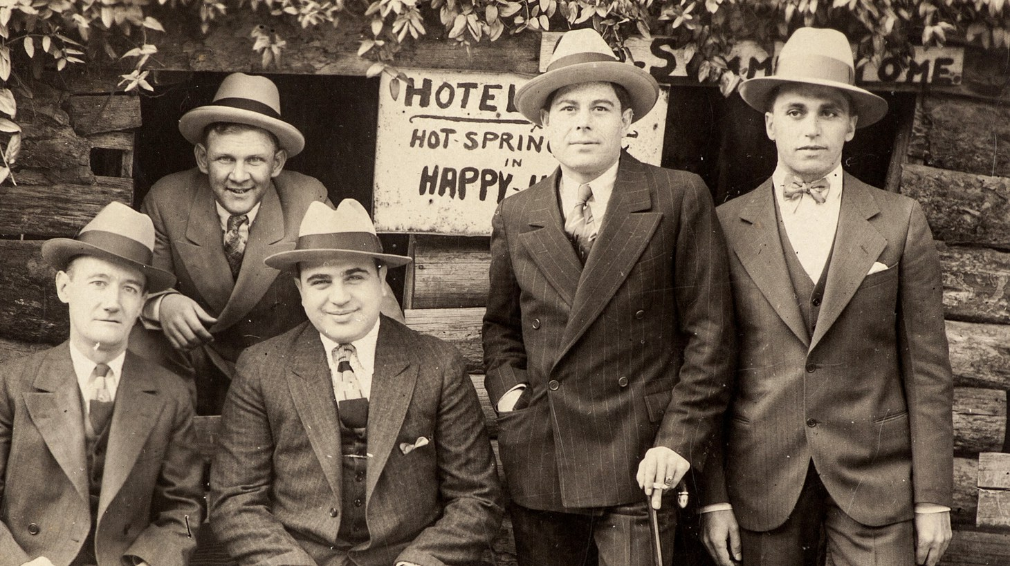A vintage silver print photo shows Al Capone with associates at Hot Springs, Arkansas in an undated photo.