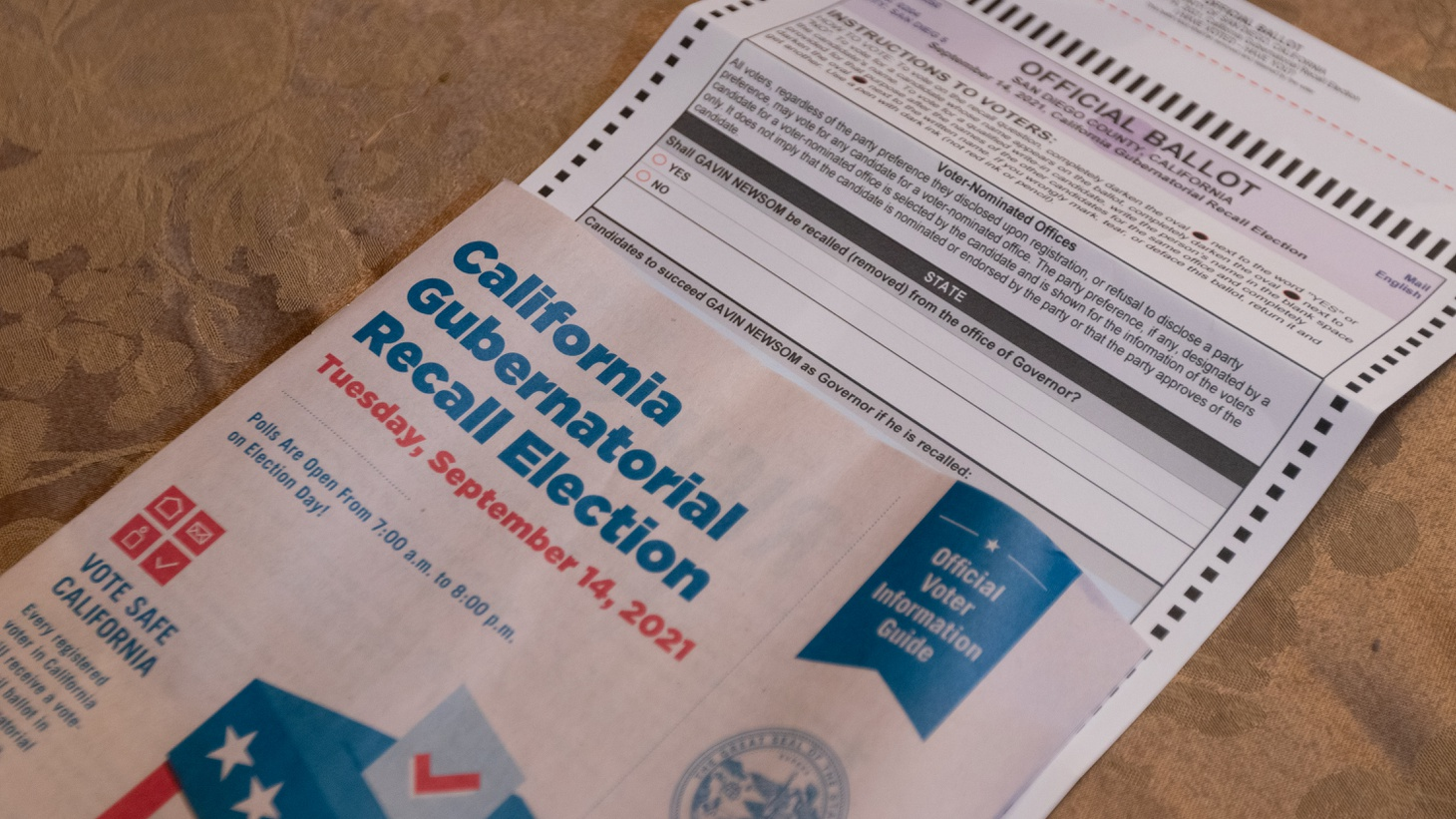 The official mail-in ballot and voter information guide for the 2021 California Gubernatorial Recall Election sits inside a home in San Diego, California on Monday, August 23, 2021.