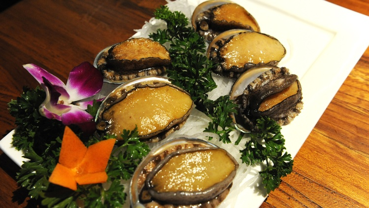 Abalone, specifically red abalone, has been a popular menu item in sushi and seafood restaurants in California. It's a sea slug that's about the size of a dinner plate.